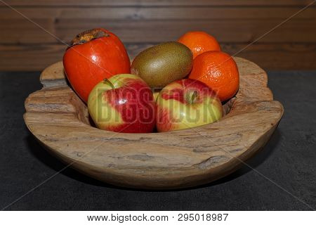 Various Fruits In A Wooden Bowl. Torfhaus, Germany