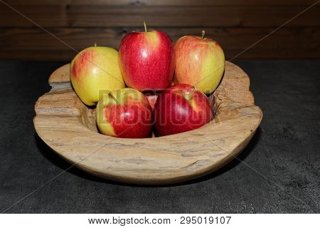 Pile Of Ripe Apples In A Wooden Bowl. Torfhaus, Germany