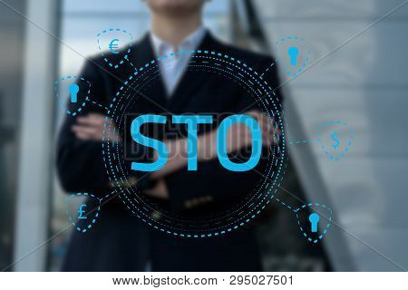 Security Token Offering Sto Cryptocurrency And Blockchain Concept, Businessman Pressing Virtual Grap