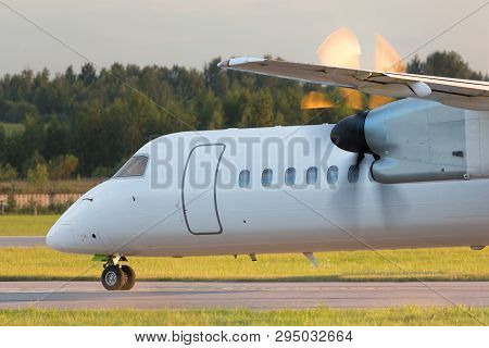 Airplane With Turboprop Engine With Propeller In Motion Taxing On Runway, Close Up, Horizontal, Part