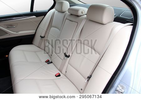 White Rear Seat Of A Luxury Passenger Car