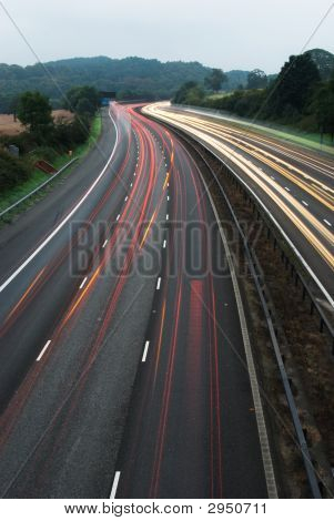 White and red light trails from long exposure photo off M6 poster