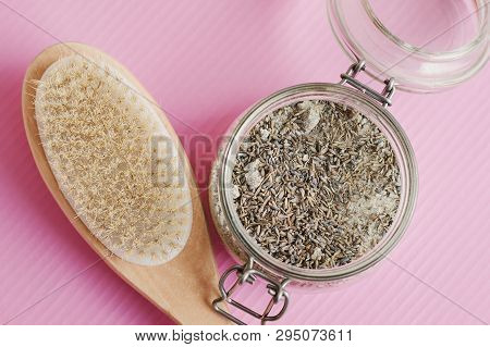 Wooden Brush For Dry Massage And Body Scrub With Salt And Lavender On Pink Background. Cellulite Tre