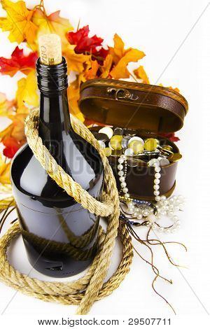 Bottle Of Wine Against The Chest With A Treasure