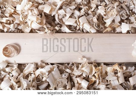 Wooden Table With Sawdust. Joiner Carpenter Workplace Top View.
