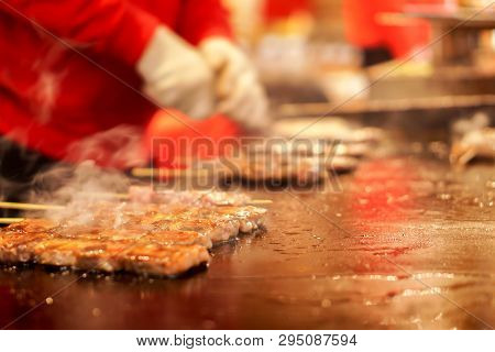Closeup Kobe Beef Stick On A Hot Pan To Sale For Customer At Kuromon Market On Blurry Hands Of Chef