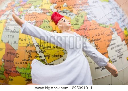 Swirling dervish in front of a globe on a textured background poster
