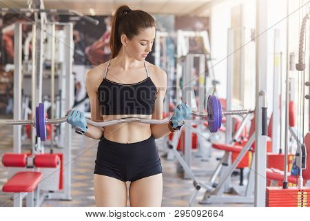 Image Of Young Athletics Girl Training Hard With Barbell In Gym. Fitness Muscled Woman In Sport Clot