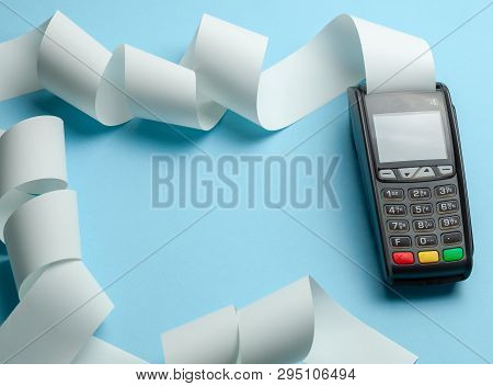 Terminal Cash Register Machine Pos For Payments And Long Roll Cash Tape On Blue Background. Copy Spa