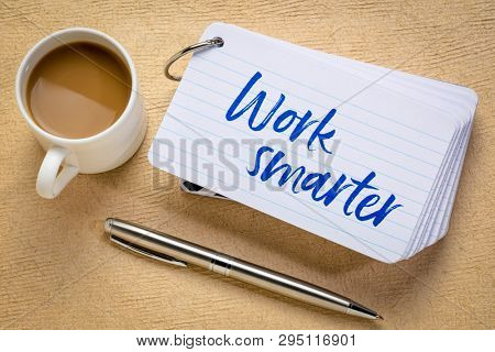 work smarter reminder - handwriting on a stack of index cards with a cup of coffee and a pen against textured bark paper