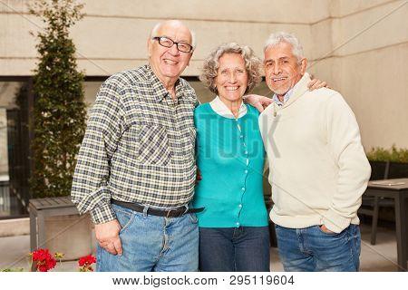 Three happy seniors retired in retirement home or senior residence