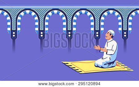 Moslem Male Sit And Pray Near Decorative Mosque Gate.