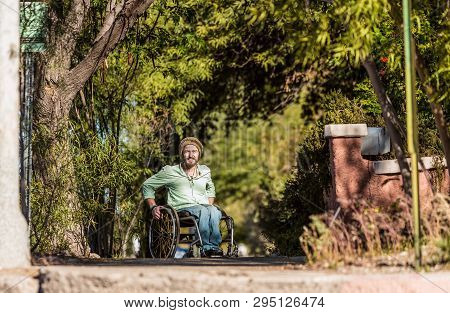Young Man In Wheelchair On A City Street