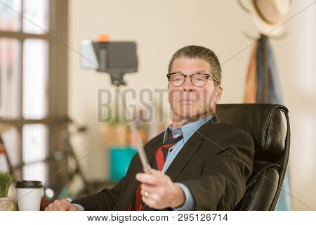 Business Man Taking A Serious Selfie In His Office