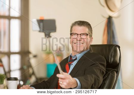 Business Man Taking A Silly Selfie In His Office