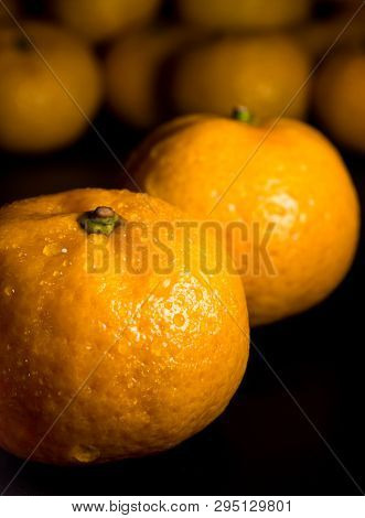 Water Droplet On Glossy Surface Of Freshness Orange On Black Background