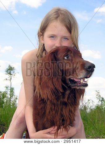 Girl With The Dog Against The Background Of The Sky