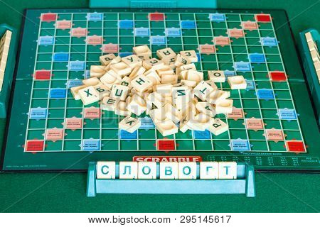 Moscow, Russia - April 3, 2019: Pile Of Letter Tiles On Board Of Russian Edition Of Scrabble Game .
