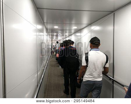 Chiang Rai, Thailand - March 29 : Unidentified Travelers Walking Inside Aero Bridge Or Jetway At Air