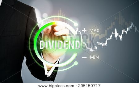 Close up of businessman hand using digital button touchscreen on blurry background. Dividend and innovation concept. Double exposure poster