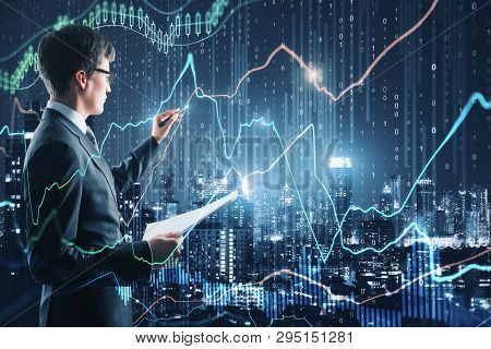 Attractive Businessman With Forex Chart