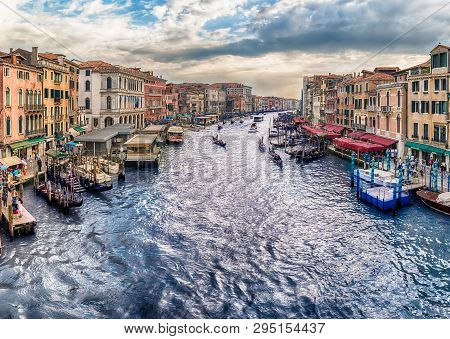 Venice, Italy - April 29: Panoramic View Of The Grand Canal At Sunset From The Iconic Rialto Bridge,