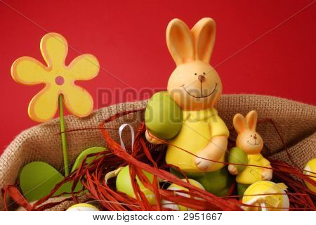 Colorful Easter eggs and two bunnies with a flower poster