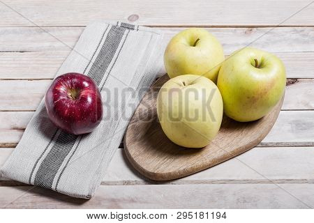Raw Delicious Apples Golden On Wood Background
