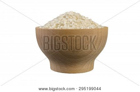 Arborio Risotto Short Grain Rice In Wooden Bowl Isolated On White Background. Nutrition. Food Ingred