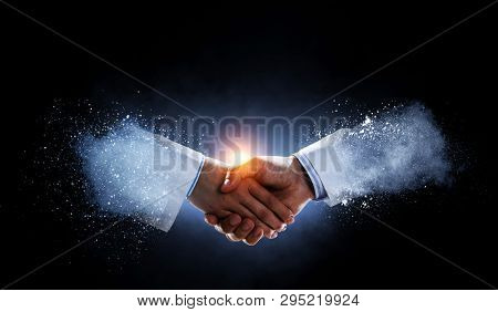 Business handshake by a man and a woman.
