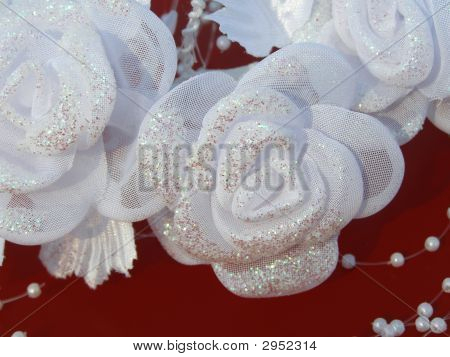 White Wedding Flowers Against The Red Background