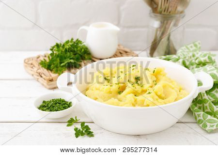 Mashed Potato With Butter And Milk On Table