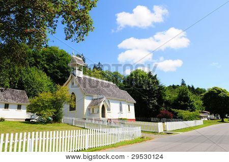 Little church with white fence in Alert Bay, Vancouver Island, Canada