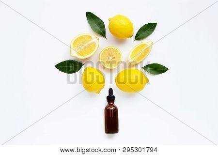 Essential Oil With Lemon And Green Leaves Isolated On White Background.
