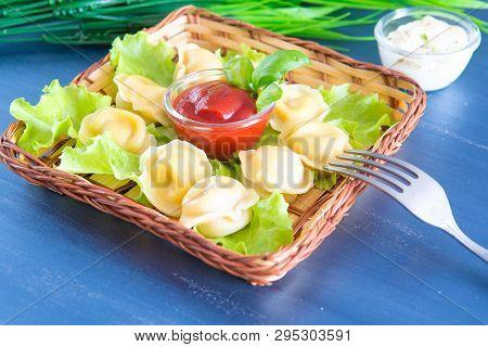 Steamed Korean Dumplings Mandu With Chicken Meat And Vegetables On A Black Plate, Horizontal Fresh B