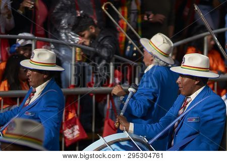 Oruro, Bolivia - February 25, 2017: Band Of A Diablada Dance Group Parading Through The Mining City