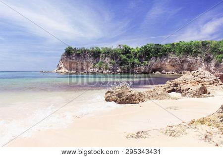 Pastel Toned Seaside Summer Vacation Location. View On Calm Sea And Rocky Shores, Macao Beach Domini