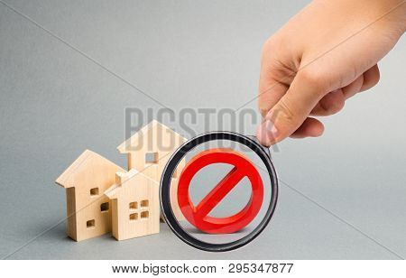 Magnifying Glass Is Looking At The No Sign And The Wooden House. Unavailability Of Housing, Busy Or