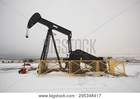 Close Up View Of An Oil Pump In Winter Season
