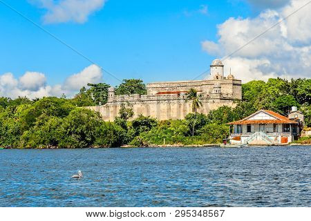 Jagua Castle Fortified Walls With Trees And Fishing Boats In The Foreground, Cienfuegos Province, Cu