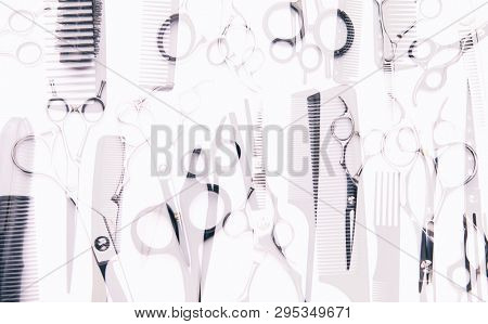 Stylish professional barber scissors, combs, brushes, hairdresser salon concept, hairdressing tool set. Haircut accessories abstract background