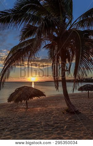 Rancho Luna Caribbean Beach With Palms And Straw Umbrellas On The Shore, Sunset View, Cienfuegos, Cu