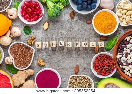 Frame Of Superfood Clean Eating Selection: Fruit, Vegetable, Seeds, Superfood, Nuts, Berries On Conc