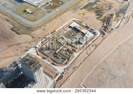 Aerial Top View Of The Foundation Of Buildings Under Construction Multistoried Living Space And Cons