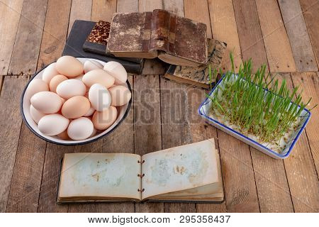 Eggs From Hens And An Old Notebook On A Wooden Kitchen Table. Fresh Rye Sprouts In A Porcelain Bowl.