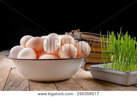Eggs From Hens On A Wooden Kitchen Table. Fresh Rye Sprouts In A Porcelain Bowl.