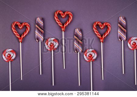 Many Lollypops, Striped Lollypop Looks Like An Ice-cream, Round Swirled And Hart Shaped  On A Stick