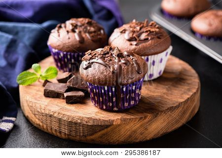 Chocolate Muffins On Wooden Serving Board. Homemade Chocolate Cakes