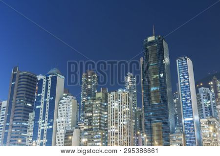 High Rise Building And Skyline Of Hong Kong City At Night