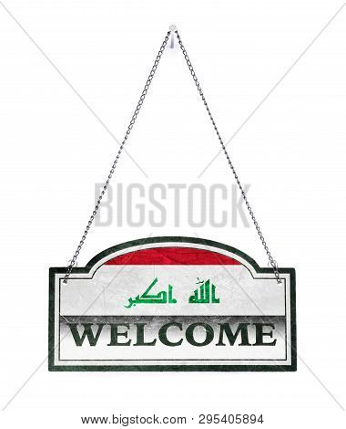 Iraq Welcomes You! Old Metal Sign Isolated On White